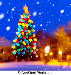 Christmas background with unfocused Christmas tree and snow...