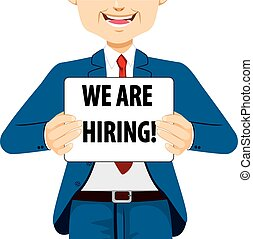 We are Hiring Banner - Businessman holding white banner with...