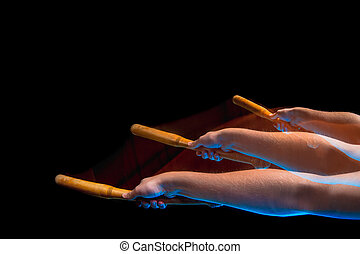 The arm with wooden baseball bat on black background - The...