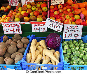 Fresh English fruit and vegetables on a market stall in...
