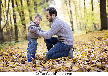 nature with dad in forest autumn - Exploring the nature with...