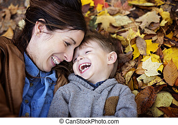 Mother with son in forest in autumn - A Mother with son in...