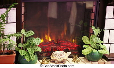 Artificial fire in fireplace - The stone fireplace rises...