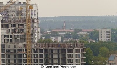 Construction workers on construction site - building new...