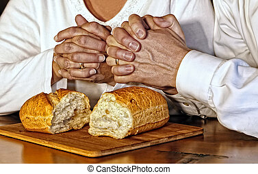 Giving Thanks in Prayer - A husband and wife pray together,...