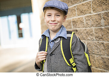 Pre teen boy at school with smile