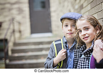 Pre teen child at school - Two Pre teen child at school...