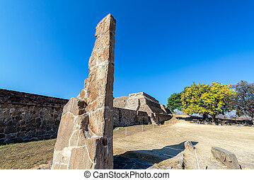 Stele and Ruins - Stele and temple in the ruins of Monte...