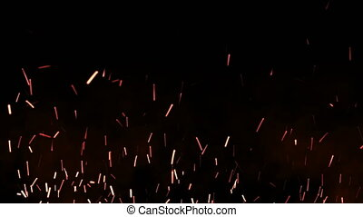Beautiful fire sparks in the night, dark background. Loop...