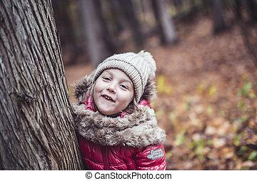 kid girl in autumne season wearing a hat - A kid girl in...