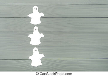 Paper silhouette of three white ghosts - Left side of paper...