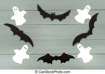 Halloween holiday background made of frame with bats and...