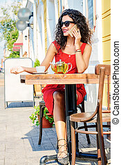 woman in a caf - Charming brunette woman with beautiful...