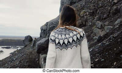 Young traveling woman hiking alone in the mountain, walking...