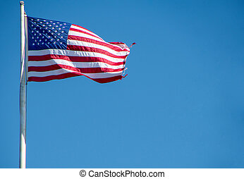 American flag with frayed edge - American flag on pole with...