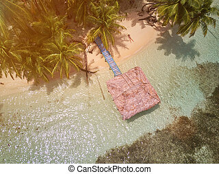 Above view on bungalow at caribbean sea sunny light day