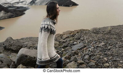 Young traveling woman hiking in the Vatnajokull glaciers ice...