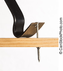 A pry bar removing a nail - A pry bar is shown removing a...