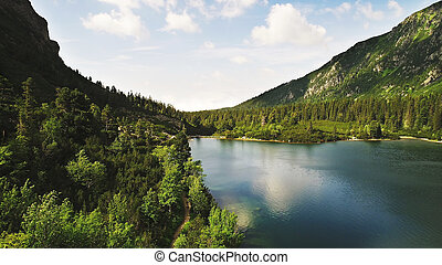 mountain  landscape. Shallow river flows among mountains