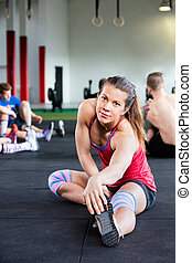 Confident Young Woman Doing Stretching Exercise - Portrait...