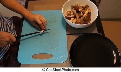 Man cut mushrooms - Man hand cut wild mushrooms. Chop fresh...