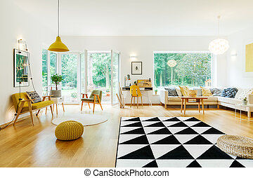 Lamps and poufs in room - Lamps and poufs in spacious living...