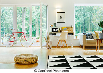 Red bicycle in open space - Red bicycle and pouf in open...