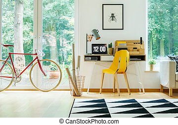 Interior with red bicycle - Red bicycle in workspace...