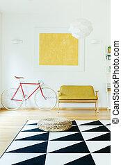 Geometric carpet in living room - Pouf on geometric carpet...