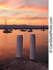 Boat moorings at sunset from the timber jetty.