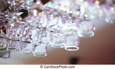 Glasses over the bar - In the iron holder glassware above...