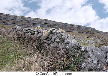 burren stone wall - rock formation in rocky lanscape of the...