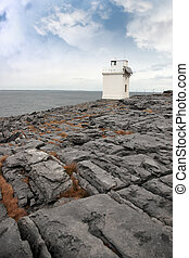 burren lighthouse - lighthouse on rocky landscape of the...