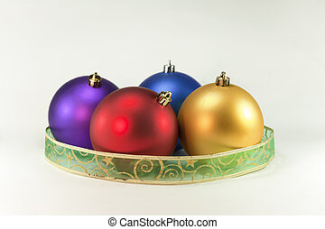 four ball christmas - four colored balls surrounded by a...