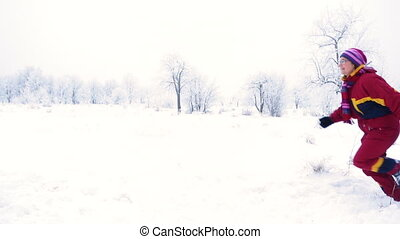Three people running together on winter landscape - Family...