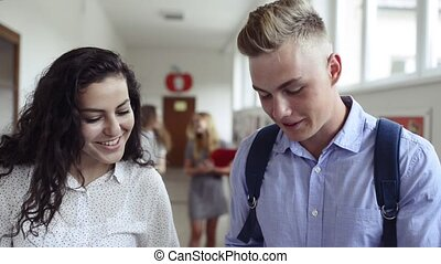 Teenage student couple in high school. - Attractive teenage...