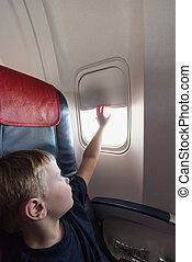 in the cabin of the plane the boy - in the cabin of a small...