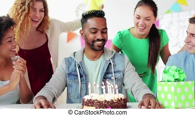 team greeting colleague at office birthday party -...