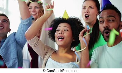 happy team throwing confetti at office party - corporate,...