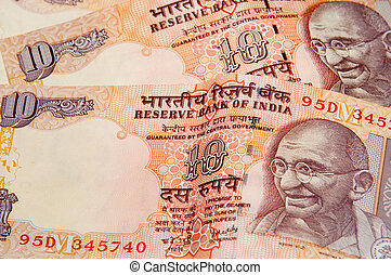 Indian Rupee - Indian rupee notes with portraits of Gandhi.