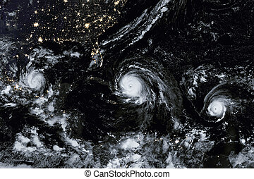 A Menacing Line of Hurricanes. Elements of this image are...