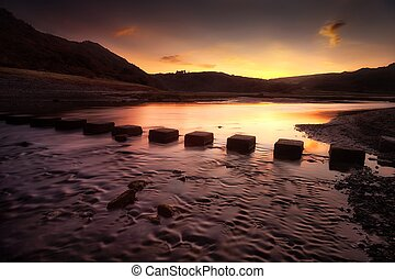 Sunrise at Three Cliffs Bay - Sunrise over the stepping...