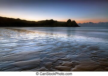 Daybreak at Three Cliffs Bay - Daybreak at low tide at Three...