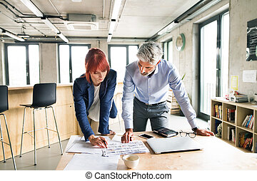 Business people in the office talking together. - Two...