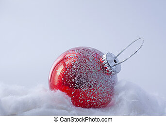 Christmas bauble - Red Christmas bauble laying over fake...
