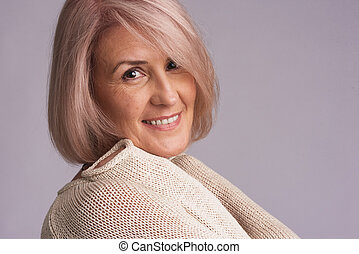 portrait of a beautiful older woman smiling - Close up...