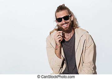 Cheerful hipster man looking camera isolated - Image of a...