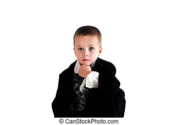 Boy Thinker - Little boy kneels and rests his chin on his...