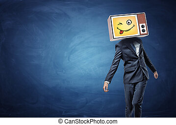 A strangely walking businessman wears a vintage TV on his...