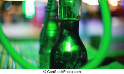 hookah with coal close up in night bar with bokeh lights....